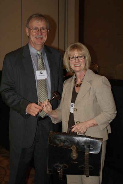 Outgoing President Jerry Bradley passes the gavel to Peggy Kulesz, CCTE President for 2009-10